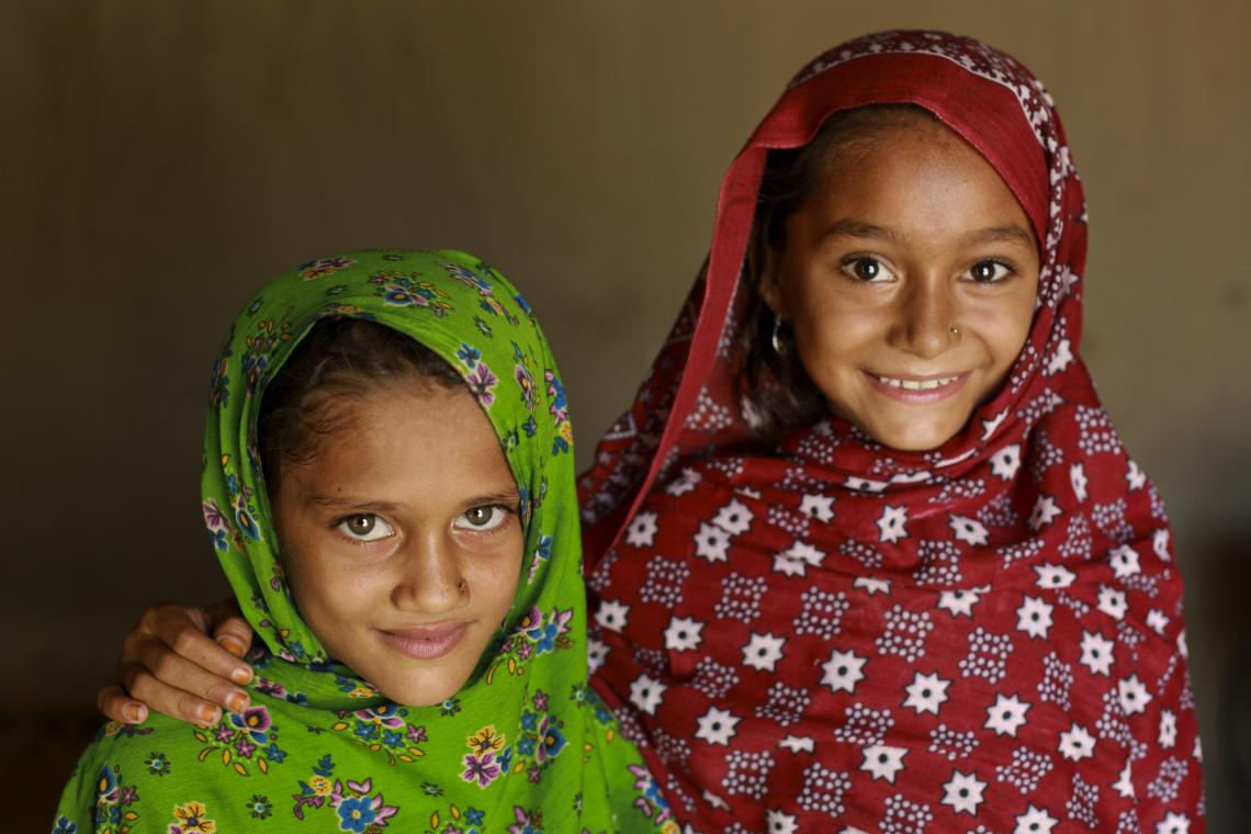 Rehana and her sister smiling at home