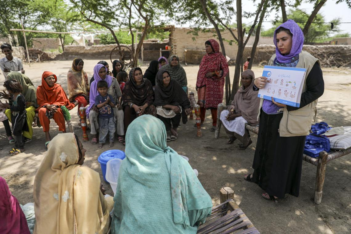 A social mobilizer conducts a health and hygiene session