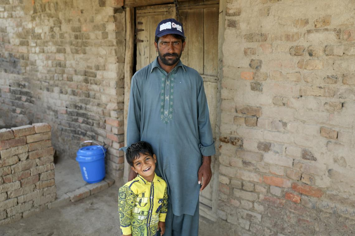 Abdur Razzaq with his son at home