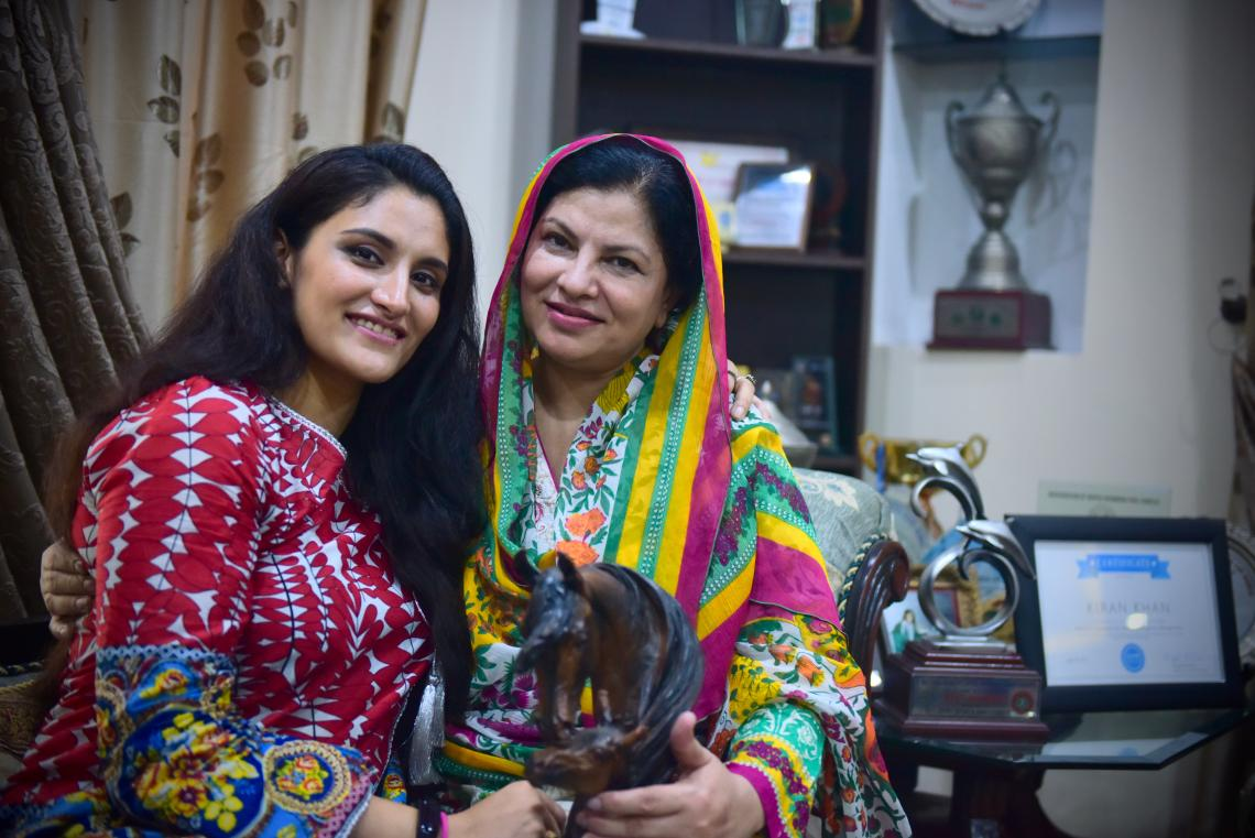 Kiran Khan sits with her mother