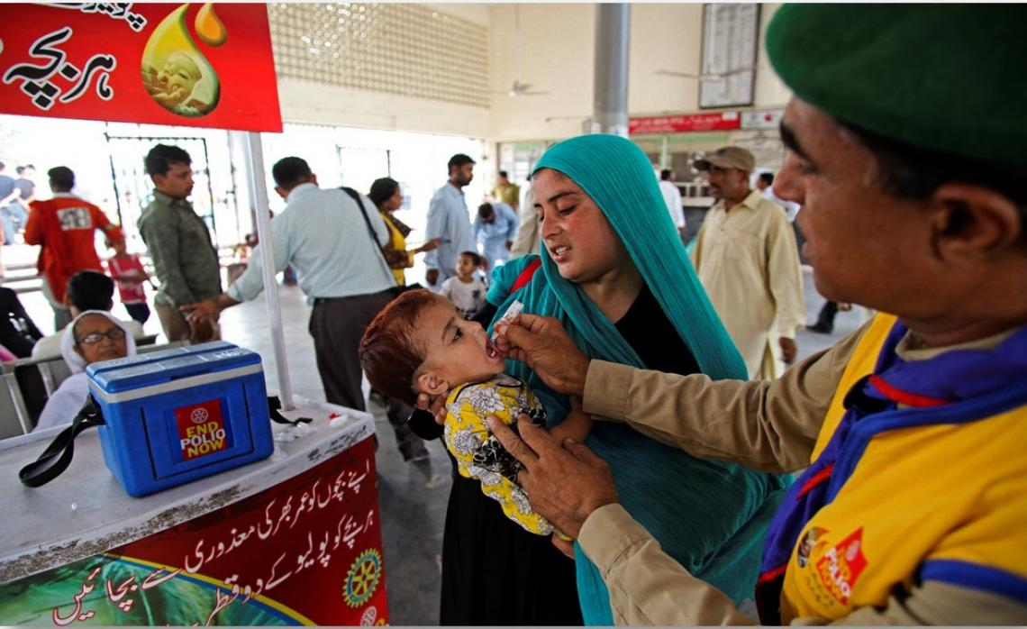 Polio drops being administered to an infant