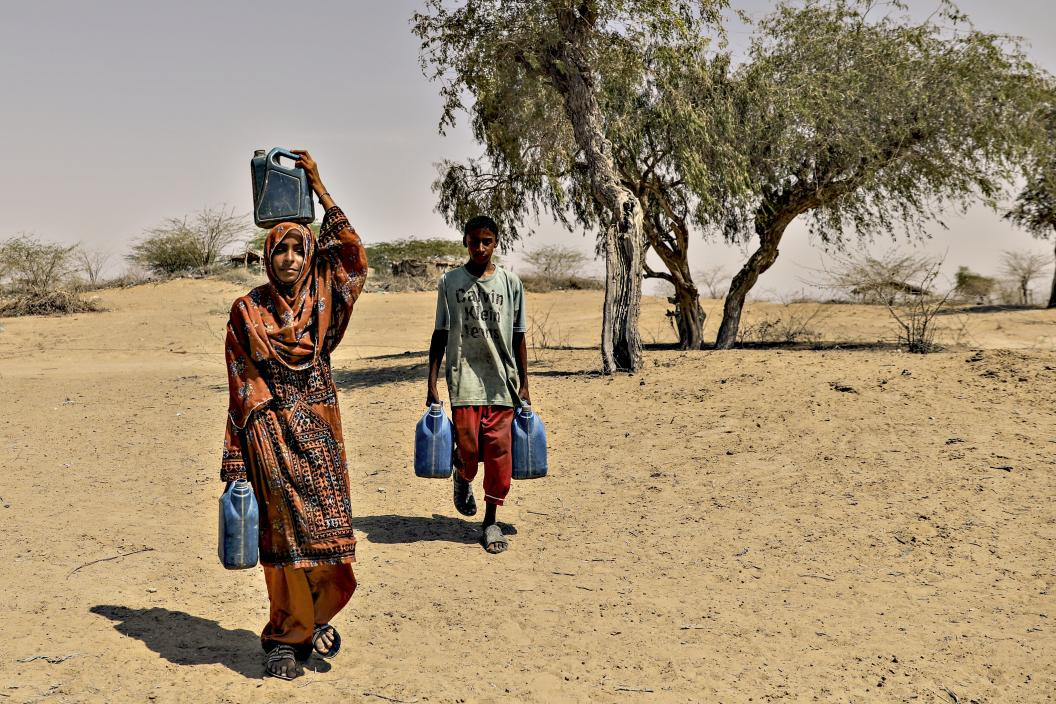 Shahnaz and her brother fetching water from a well in their village