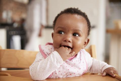 A baby girl shows signs of being hungry