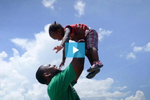 A father holds his child in the air