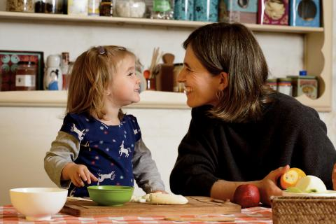 On 10 July, 2019, Matilde, 2, prepares fruit salad with her mother, Carolina, in the kitchen of their home in Montevideo, Uruguay. They enjoy spending time together preparing healthy foods to eat.