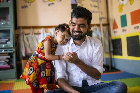 Yogesh Kulkarni plays with his 2-year-old daughter Manyata at an Anganwadi centre in Karmad, Aurangabad.