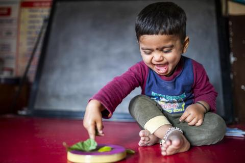 Vivek, 20 months, plays in Paithan, Aurangabad, India.