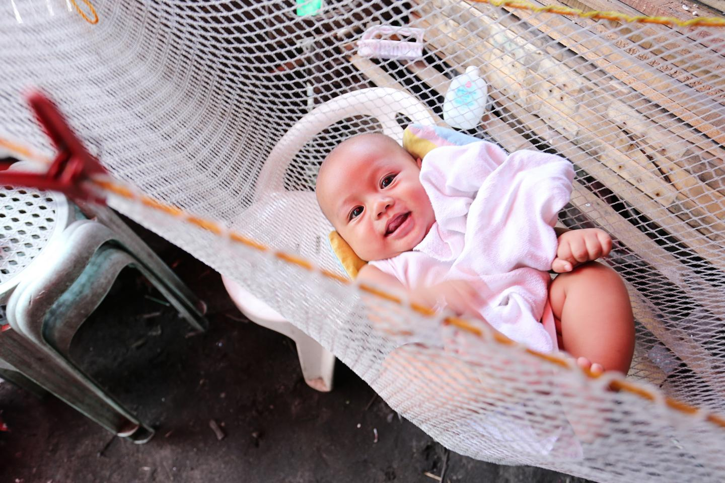 A smiling baby on a hammock