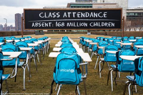 An installation of UNICEF cyan backpacks and desks at the UN Headquarters