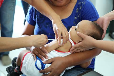 A child gets vaccinated at a health centre