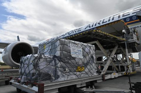 A shipment of COVID-19 vaccines being unloaded from a passenger airplane