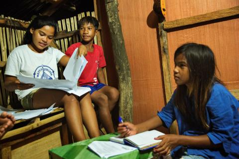Melecio sibling do their home work together during COVID-19
