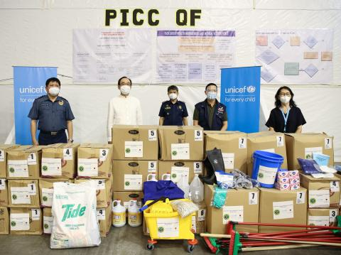 Officials of UNICEF, the Department of Health, Philippine National Police and the Embassy of Japan stand behind UNICEF supplies