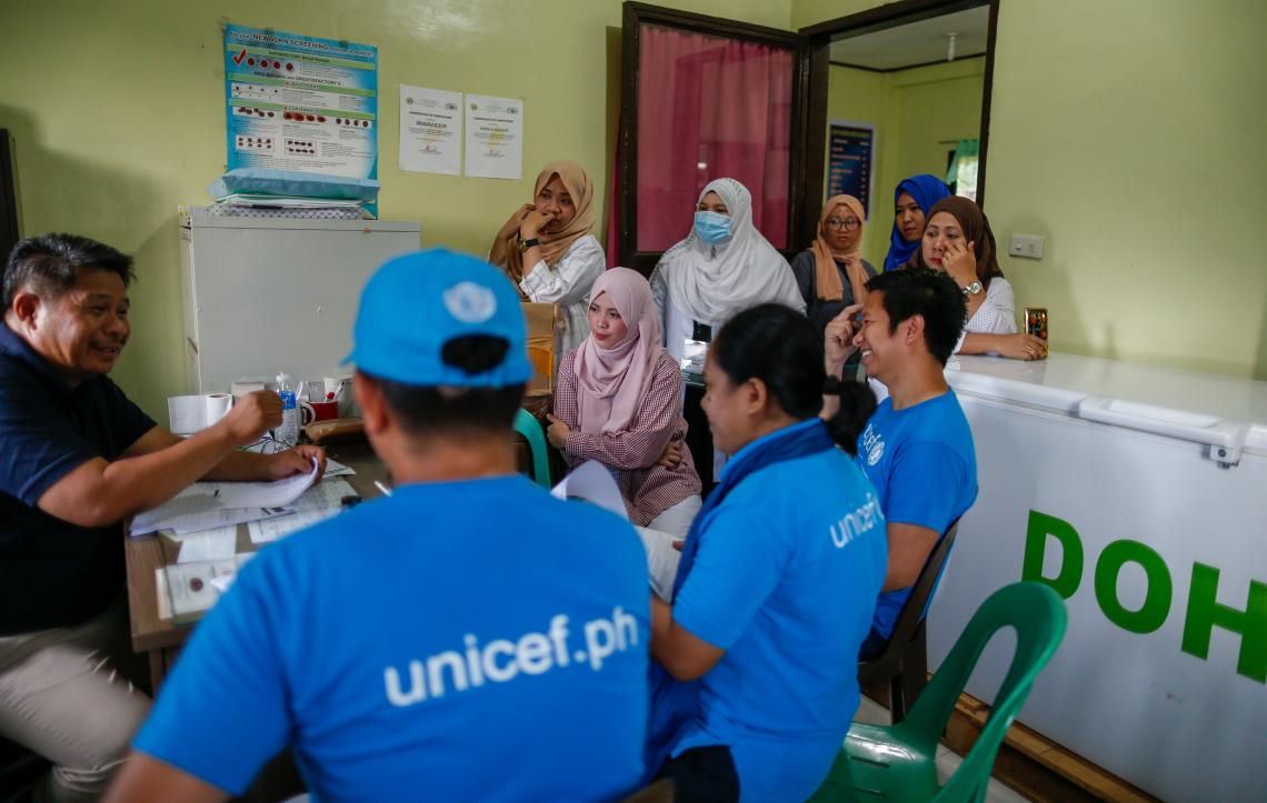 UNICEF staff visit a health center to assess preparations for the polio immunization campaign