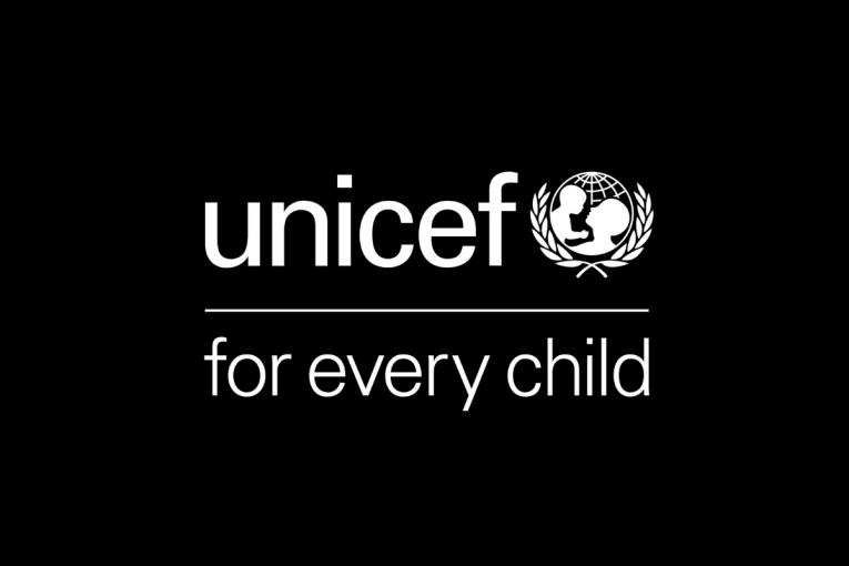 "UNICEF logo with tagline ""for every child"" against a black background"