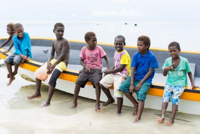 Children sitting on a boat.