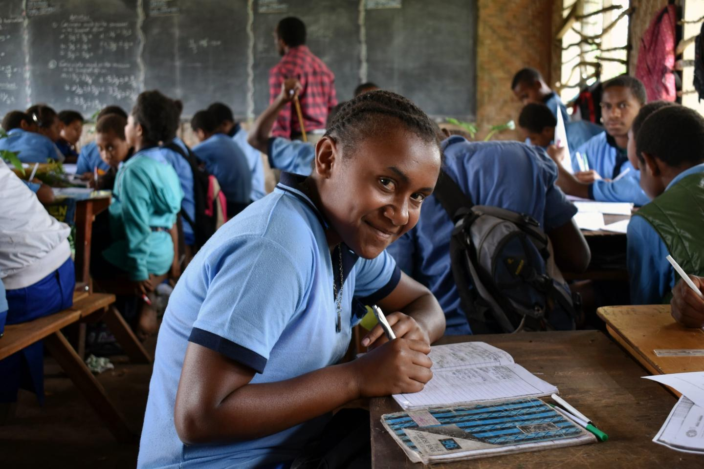 Grade six student, Bevelyn Moses, happy to be back in class after the prolonged drought.