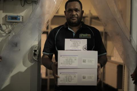 Philip Posou,  Senior National Vaccine Logistic & Cold Chain officer with the National Department of Health prepares COVID-19 vaccines to be distributed across the country in time for the national vaccination roll out.