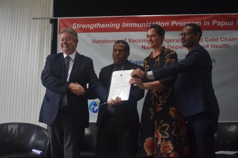 Representatives from UNICEF, Health Department, Gavi The Vaccine Alliance and WHO show off the Certificate of Handover of cold chain equipment