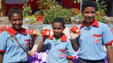 Sacred Heart Catholic Primary School children show off the bar soaps donated to their school.