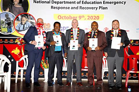 (Left–Right) Gerry Dyer - Regional Director, Save the Children), Dr. Uke Kombra – Secretary, National Department of Education, Andrew Egan – Minister Counsellor Governance, Australian High Commission, Joseph Yopyyopy – Minister for Education, after the launch of the Education Emergencies Response and Recovery Plan.