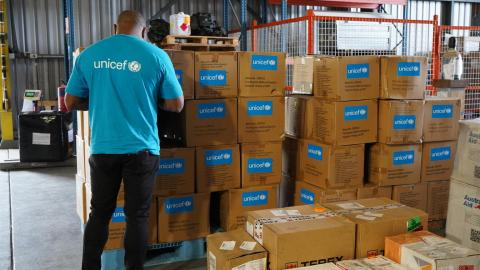 A UNICEF worker prepares boxes of hygiene and dignity kits that were airlifted to Tari, Hela Province for hundreds of people displaced by recent tribal fights.