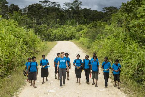 School girls on their way to class in the highlands region of Papua New Guinea near Lake Kutubu in Southern Highlands Province.