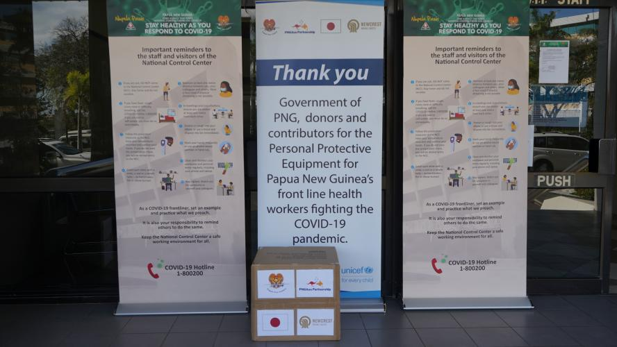 A box of PPE in front of a banner that thanks donors for their contributions
