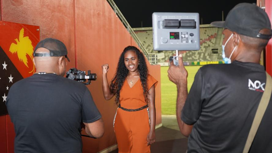 Behind the scenes – UNICEF Youth Advocate, Leoshina Kariha recording a video at the National Football Stadium in Port Moresby to promote COVID-19 awareness