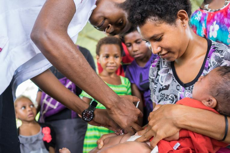 A child receiving an immunisation shot during a mobile outreach near Madang town in Madang Province.