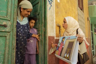Egypt, 2007: Health workers conduct home visits to teach families how to prevent the spread of influenza.