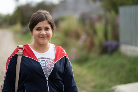 Ionela, 14, on her way back home after classes. She attends Grigore Antipa Technological High School in Bacău and is supported through the QIE transition programme.