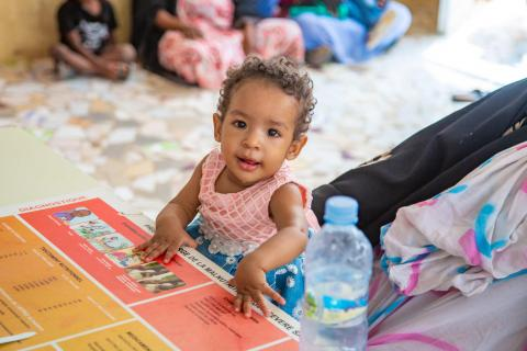 During a consultation at the Dar Naim malnutrition rehabilitation centre in Nouakchott, a girl suffering from acute malnutrition smiles at the camera.  In the nutrition rehabilitation center of Dar Naim in Nouakchott a UNICEF nutrition specialist makes smiling a malnourished baby