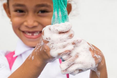Celcia Soares Baros, 6 years, rubs her hands thoroughly with soap at Escola Vila Verde in Dili, Timor-Leste.