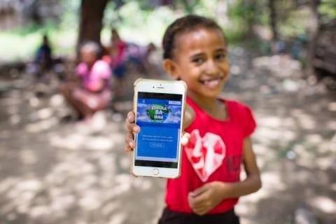 On 14 April 2020, a girl shows off the online platform on which children and parents in Timor-Leste can access a range of audio-visual material to help students continue learning during ongoing school closures.