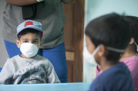 Young boys wear masks to protect against coronavirus