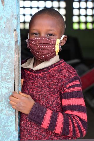 A boy wearing a mask to protect himself against COVID-19, in Youpougon, a suburban of Abidjan, in the South of Côte d'Ivoire.