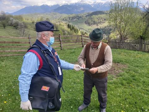 Postmaster Marian Cioacă delivers UNICEF flyers providing essential information on correct hygiene and prevention of COVID – 19 as well as ways to spend time in isolation in Moeciu de Jos, central Romania, on May 5, 2020.