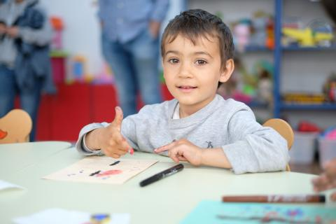 A child playing in kindergarten part of UNICEF Quality Inclusive Education Package
