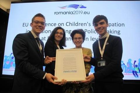 "Tudor, Alexandra, Ariana and Rareș hold a short version of the ""Bucharest EU children's Declaration"" at the end of the ""Children's Participation in Decision-Making and Policy-Making at European Union level"" international conference on May 7th, 2019, in Bucharest, Romania"
