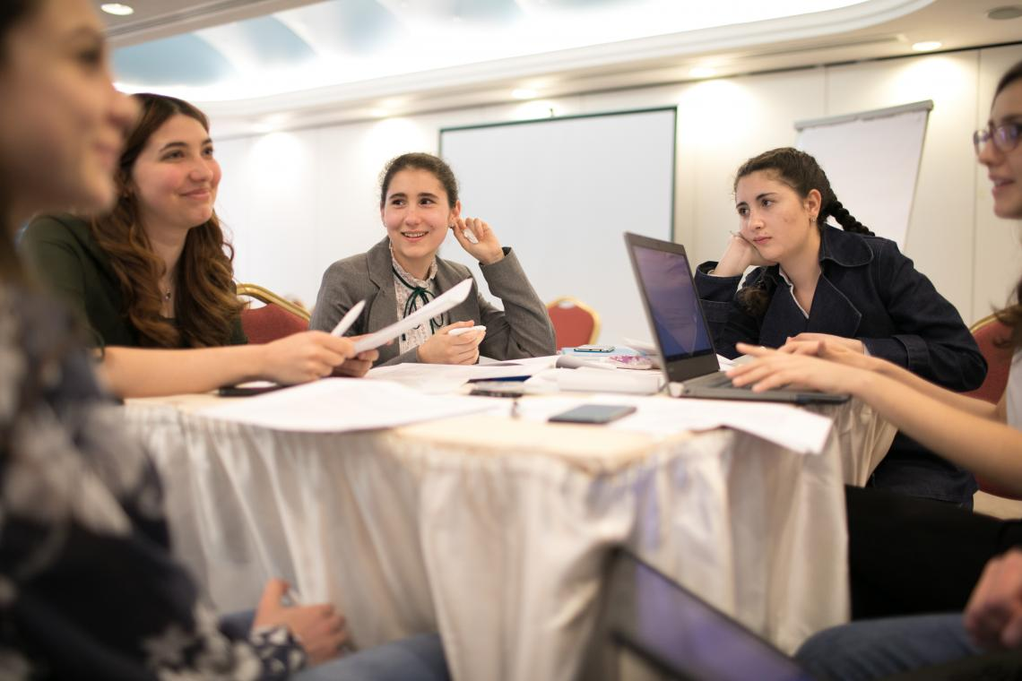 Dana-Patricia, left, Lorena, center and Dana, right, are talking during a meeting of the Romanian Children's Board, on April 19, 2019, in Bucharest, Romania. For the past months, the Romanian Children's Board has been meeting online and offline to work on the draft Declaration, a call on political leaders to consult children in decision-making processes.