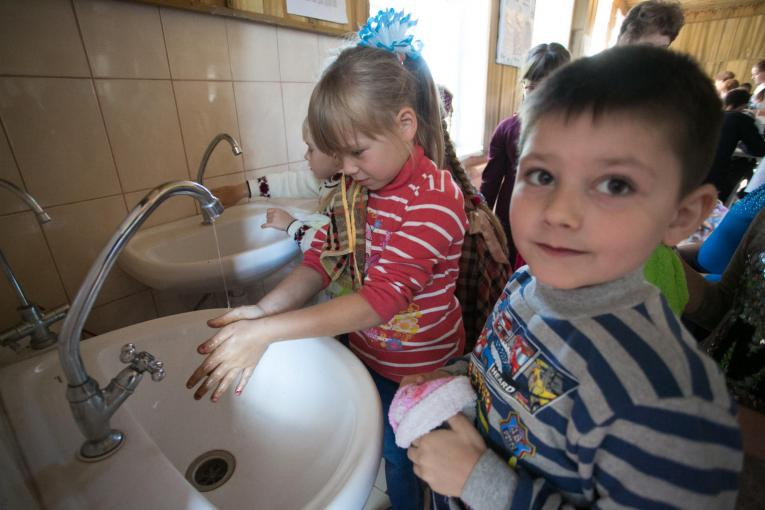 Children wash hands at the canteen of Secondary School No 20 in Toretsk, Donetsk region. Teachers and children experience regular water cuts due to the damaged water infrastructure. The school No 20 is located 10 km from the contact line, and it t was hit by shrapnel shells many times since the beginning of the conflict.