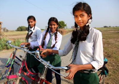 girls going to school in cycle