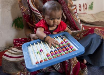 early childhood development_young baby with abacus
