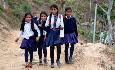 School girls in uniform going to school in Nepal village