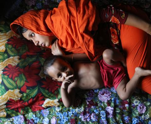 Young Bangla child bride with baby