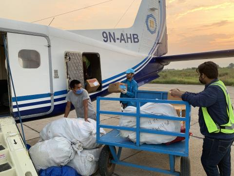 UNICEF staff at the airport in Nepalgunj in Banke District loading nutrition supplies onto an aircraft headed to remote Humla District, lying at an altitude of 9,500 feet above sea level.