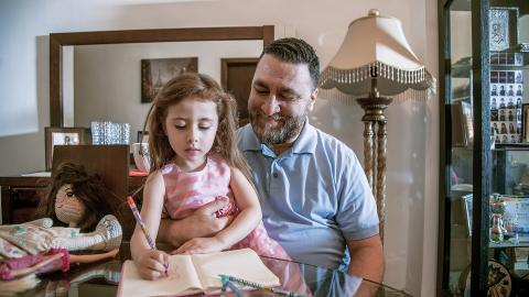 "Khaled Elahmad, caregiver for his five-year-old daughter Natalie, at home in Jordan. ""Our children learn by watching and imitating us. The way we respond to them is important. We are their role model."""