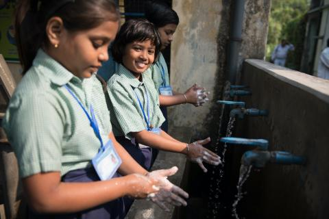STUDENTS WASH THEIR HANDS IN PURBA SIMALA SCHOOL,MOINA DANGA, , HOOGLY, WEST BENGAL, INDIA