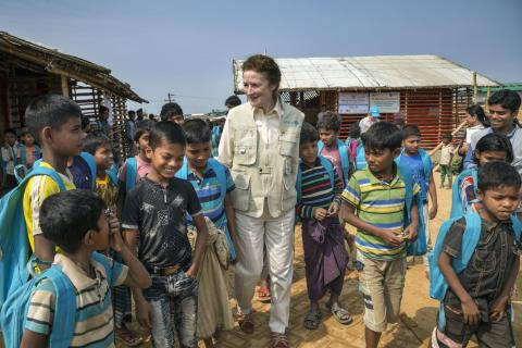 On 25 February 2019 in Bangladesh, (centre) UNICEF Executive Director Henrietta H. Fore interacts with children outside a Learning Centre in the Camp 18 section of the Kutupalong-Balukhali mega-camp in the Cox's Bazar district.